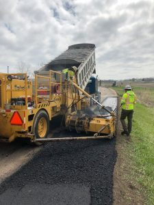 Employees working on road